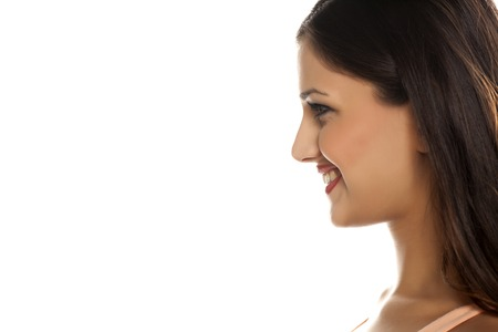 woman profile: Profile of a young smiling woman Stock Photo