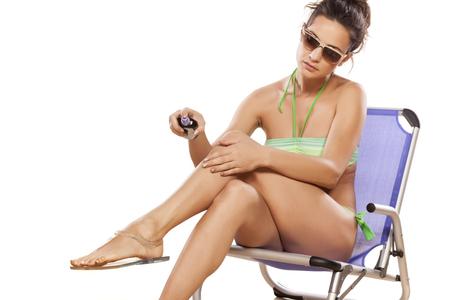 chairs: pretty girl on beach chair applied sunscreen