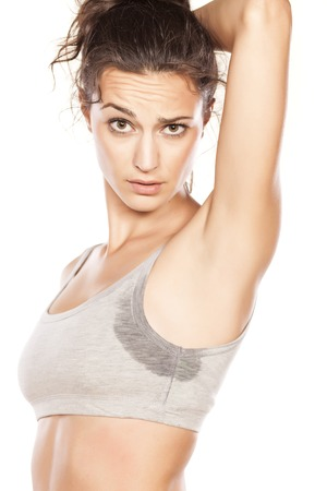 attractive girl shows off her sweaty armpits