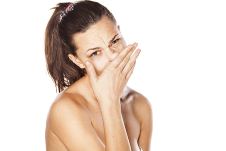 young girl rubs her nose Stock Photo