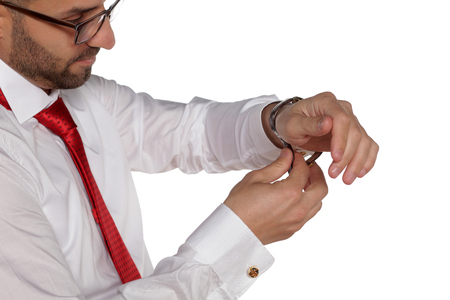 A young groom clutches his wristwatch