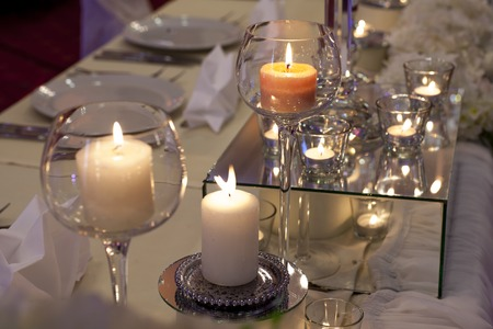 formal dinner party: decoration with candles on the table for a wedding