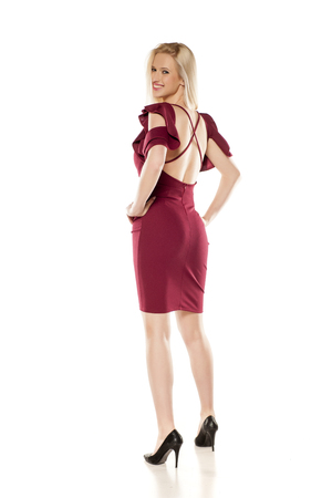 back view of attractive blonde in a short burgundy dress