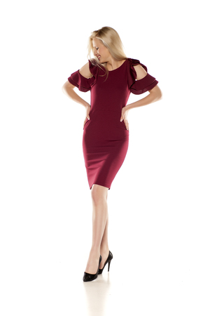 attractive smiling blonde in a short burgundy dress