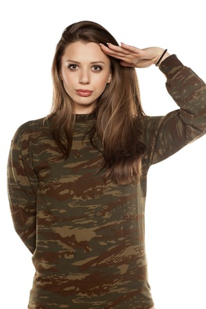 young woman wearing a camouflage blouse and salute