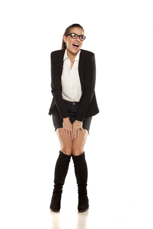 young woman in a jacket, short skirt and high boots Stock Photo