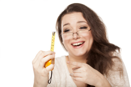 women laughed at the size shown on the measuring tape Stock fotó - 87387546