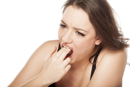 disgusted: disgusted woman puts her fingers in her mouth