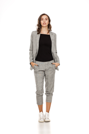 young beautiful woman in a jacket, blouse, sneakers and trousers Фото со стока - 89579643