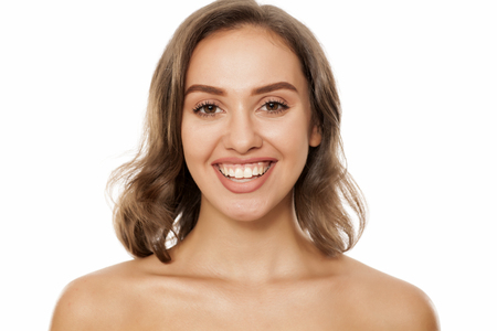 Portrait of beautiful young smiling woman on white background Reklamní fotografie