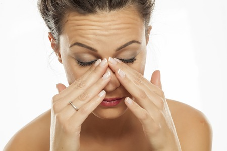 a young woman has pain in the sinuses