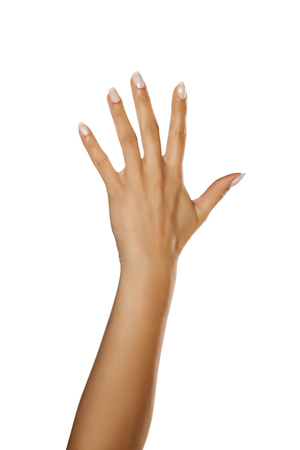 A womans palm with spread fingers