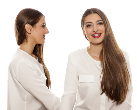 front, and side vide of young woman with long straight hair on white background Stock Photo