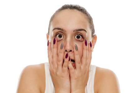 a young funny woman stretches out her face