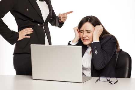 boss shout at her computer worker