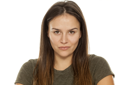 Beautiful smiling woman without makeup on white background