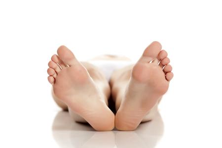 female bare feet on white background Stock fotó