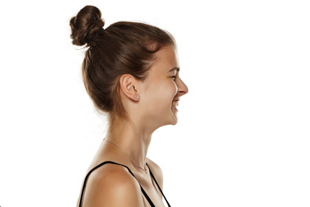 Profile of young happy woman on white background