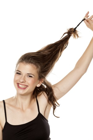 Young happy woman untie her heir on white background Stock Photo