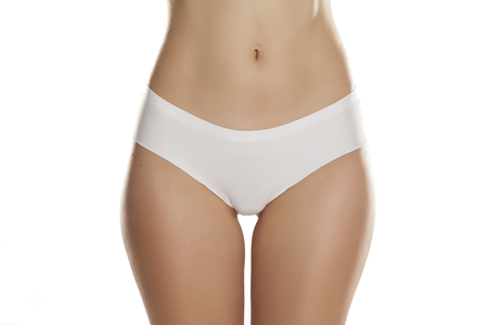 front view of female hips with white panties on white background Banque d'images