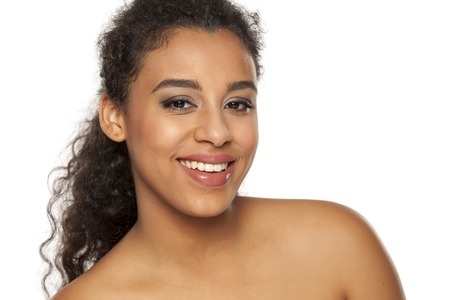 portrait of young beautiful dark-skinned woman on a white background Imagens