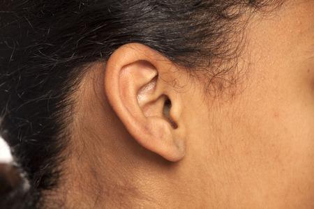 ear closeup of dark skinned female