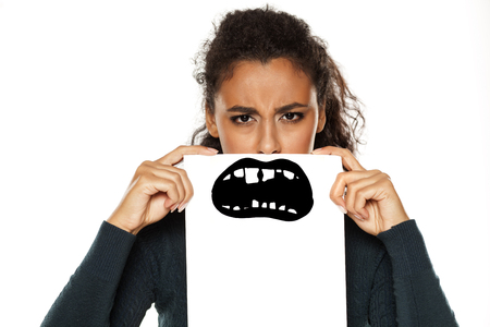 young african american woman with bad teeth drawn on paper on white background Imagens
