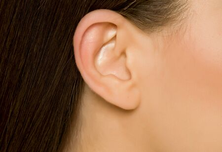Closeup of ear of young woman Standard-Bild - 129450238