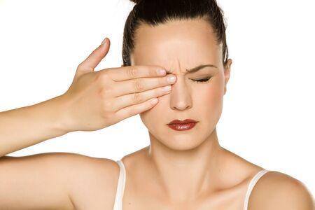 Young beautiful woman with eye pain Stockfoto