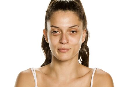 Young woman without makeup on white background