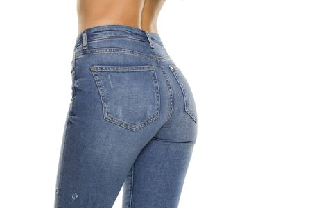 Pretty female in jeans on white background