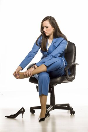 young business woman massaged her tired feet on white background