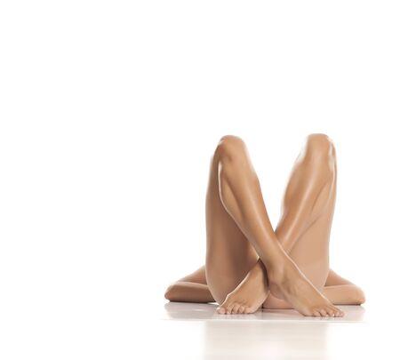 Beautiful female crossed legs on white background
