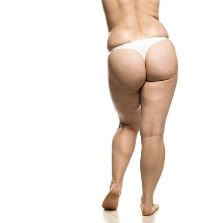 Buttocks, legs and waist of overweight woman on white background Imagens