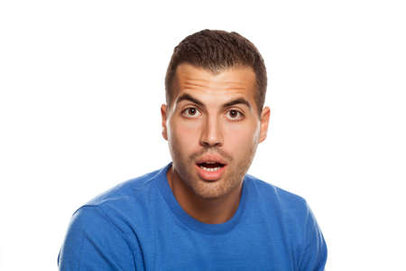 portrait of surprised young man on white background