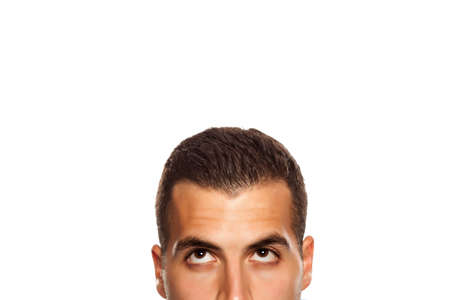 Half portrait of thinking young man on white background