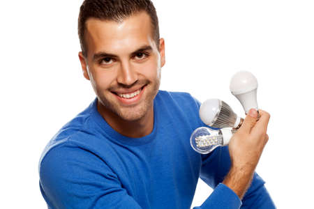 portrait of happy young man, holding three different LED bulbs on white background