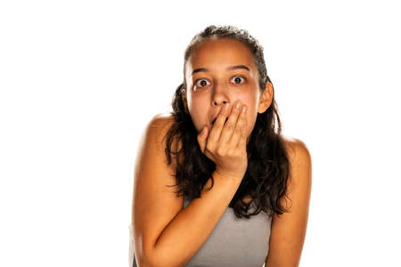 portrait of young shocked woman on white background
