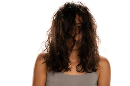 Young unknown woman with messy hair on white background Stok Fotoğraf
