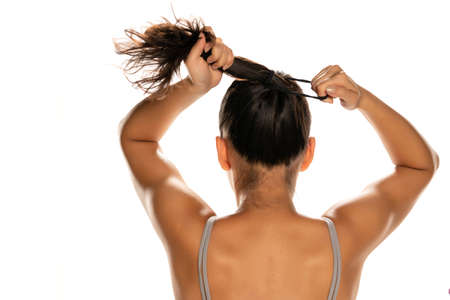 Back view of woman tie her hair