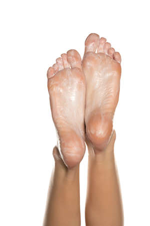 Female feet with foot mask on them on white background Stok Fotoğraf