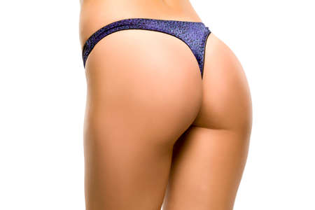 Female buttocks in thomg on white background