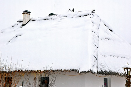 Winter cottage in the village photo