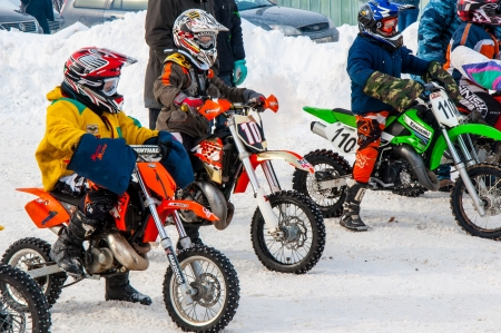 Winter Motocross competitions among children Stock Photo - 18468848