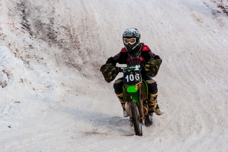 Winter Motocross competitions among children Stock Photo - 18468841