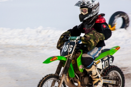 Winter Motocross competitions among children Stock Photo - 18468833