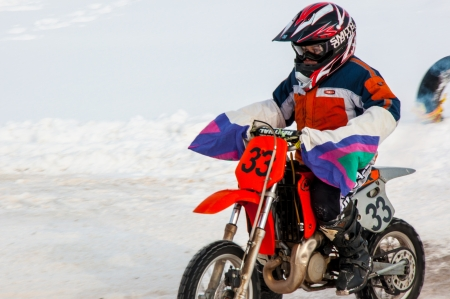 Winter Motocross competitions among children Stock Photo - 18468823