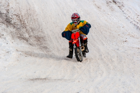Winter Motocross competitions among children Stock Photo - 18468838