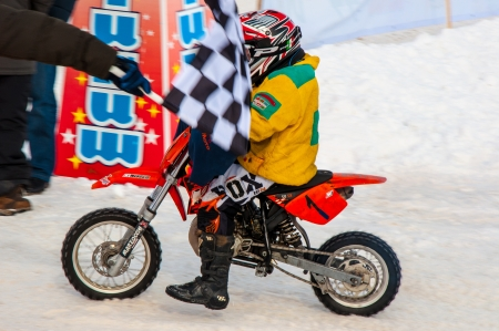 Winter Motocross competitions among children Stock Photo - 18468837