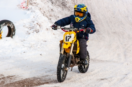 Winter Motocross competitions among children Stock Photo - 18468831